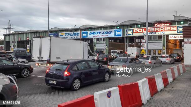 Cars waiting in line to cross the Swinoujscie Ystad route by the Unity Line TTline and Polferries ferry are seen on 29 July 2017 in Swinoujscie Poland