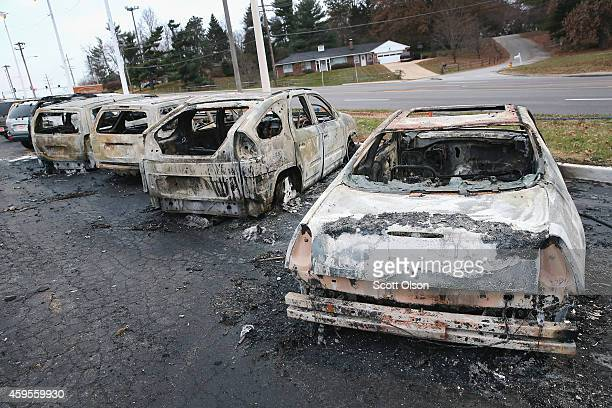 Cars which were set on fire when rioting erupted following the grand jury announcement in the Michael Brown case sit on a lot on November 25 2014 in...