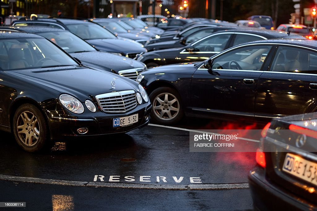 Cars with diplomatic plates are parked outside of the World Trade Organization (WTO) headquarters on January 29, 2013 in Geneva. WTO begins interviewing nine candidates to replace Pascal Lamy as director general. The WTO's 158 member countries is to make its decision known by May 31.