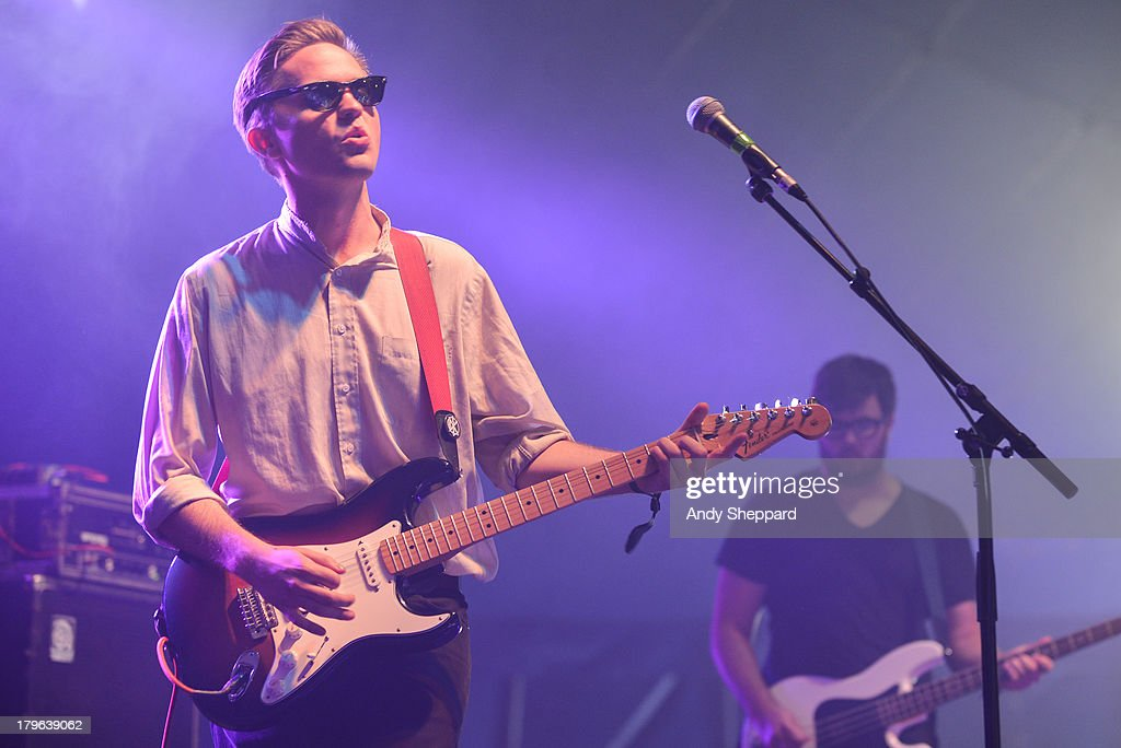Carson Cox and Patrick Brady of the band Merchandise perform on stage on Day 3 of End Of The Road Festival 2013 at Larmer Tree Gardens on September 1, 2013 in Salisbury, England.