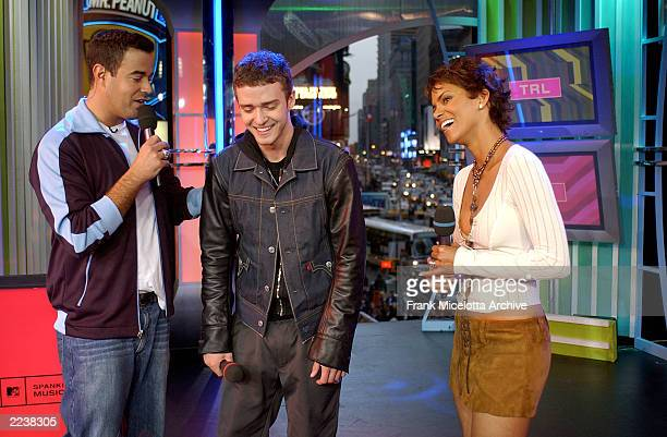 Carson Daly introduces surprise guest Halle Berry to Justin Timberlake on MTV's Spankin New Music Week on TRL at the MTV Times Square Studios in New...