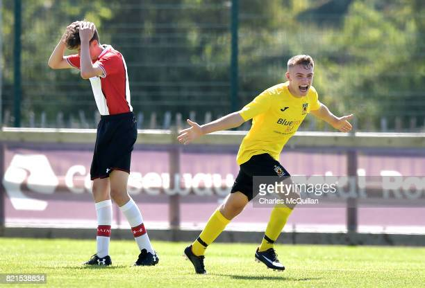 Carson Elliott of County Antrim celebrates after scoring the opening goal during the NI Super Cup junior section game between Southampton and County...