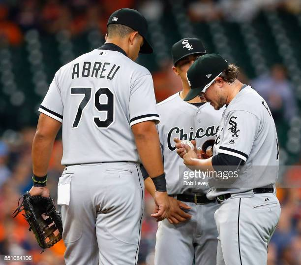 Carson Fulmer of the Chicago White Sox has his finger looked at by training staff as Jose Abreu looks on against the Houston Astros at Minute Maid...