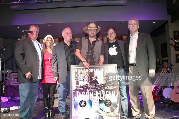 Carson James Leigh Adams Denny Brown Jason Aldean Jon Loba and Rick Shedd pose with Aldeans double platinum plaque presented at the Broken Bow/Stoney...