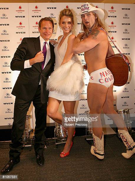 Carson Kressley poses with Jennifer Hawkins and the Naked Cowboy during a launch party for Myer's '3 weeks in New York' at Studio 54 on May 12 2008...