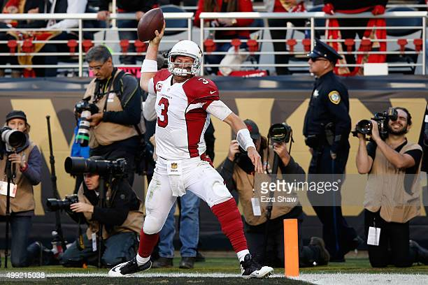 Carson Palmer of the Arizona Cardinals celebrates after a sevenyard rushing touchdown against the San Francisco 49ers during their NFL game at Levi's...