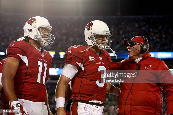 Carson Palmer of the Arizona Cardinals celebrates with head coach Bruce Arians after David Johnson scored a touchdown in the second quarter against...