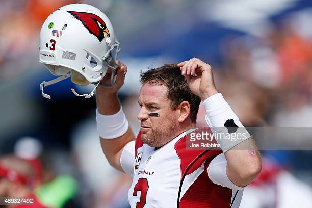 Carson Palmer of the Arizona Cardinals gets ready to take the field against the Chicago Bears in the second quarter at Soldier Field on September 20...