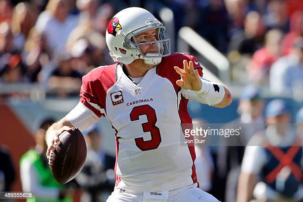 Carson Palmer of the Arizona Cardinals looks to pass against the Chicago Bears during the fourth quarter at Soldier Field on September 20 2015 in...