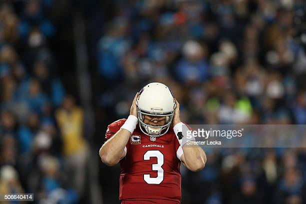 Carson Palmer of the Arizona Cardinals reacts in the first quarter against the Carolina Panthers during the NFC Championship Game at Bank of America...