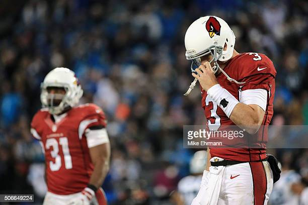 Carson Palmer of the Arizona Cardinals reacts in the fourth quarter against the Carolina Panthers during the NFC Championship Game at Bank of America...