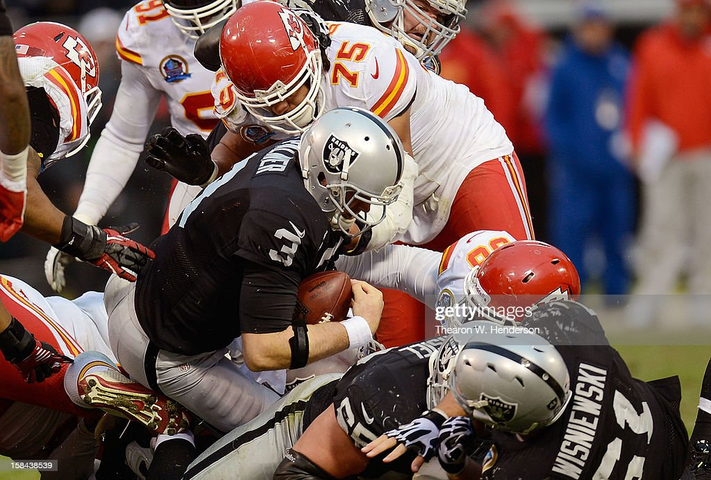 Carson Palmer #3 of the Oakland Raiders runs a quarterback keeper to get a first down against the Kansas City Chiefs in the fourth quarter at Oakland-Alameda County Coliseum on December 16, 2012 in Oakland, California. The Raiders won the game 15-0.