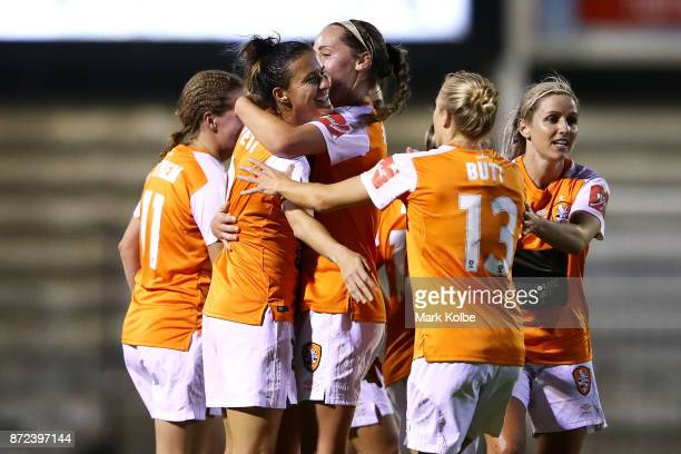 Carson Pickett of the Roar celebrates with her team mates after scoring a goal during the round three WLeague match between the Western Sydney...