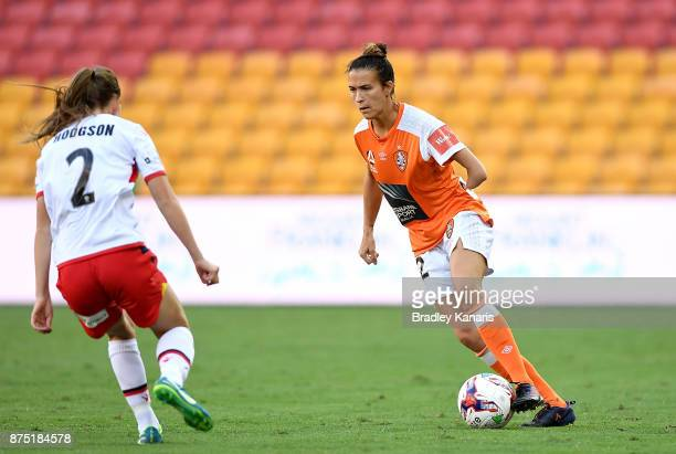 Carson Pickett of the Roar looks to take on the defence of Emily Hodgson of Adelaide United during the round four WLeague match between Brisbane and...
