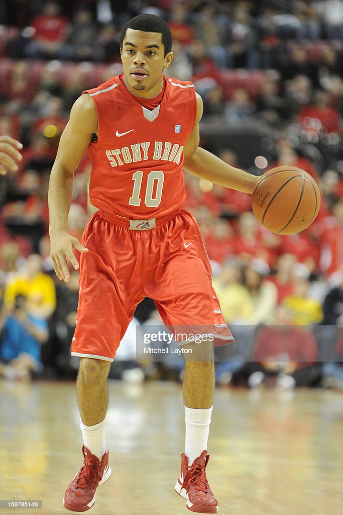 Carson Puriefoy #10 of the Stony Brook Seawolves dribbles the ball during a college basketball game against the Maryland Terrapins on December 21, 2012 at the Comcast Center in College Park, Maryland. The Terrapins won 76-69.