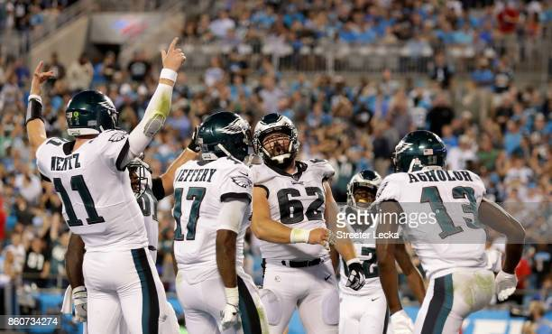 Carson Wentz celebrates with teammates after a fourth quarter touchdown against the Carolina Panthers during their game at Bank of America Stadium on...