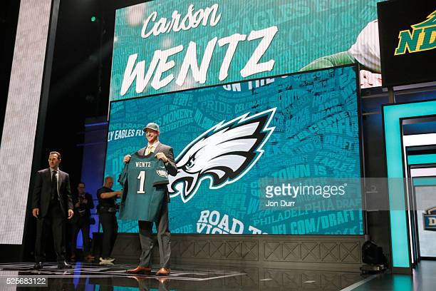 Carson Wentz of the North Dakota State Bison holds up a jersey after being picked overall by the Philadelphia Eagles during the first round of the...