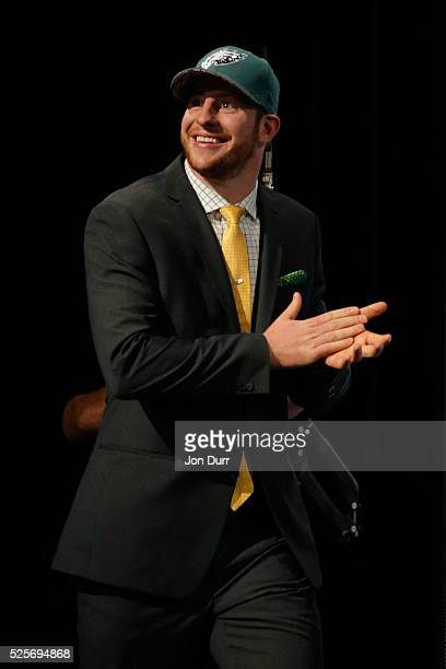 Carson Wentz of the North Dakota State Bison walks on stage after being picked overall by the Philadelphia Eagles during the first round of the 2016...