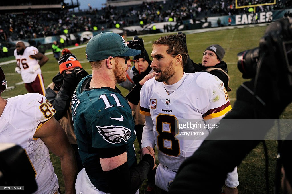 Carson Wentz #11 of the Philadelphia Eagles and Kirk Cousins #8 of the Washington Redskins meet midfield after the game at Lincoln Financial Field on December 11, 2016 in Philadelphia, Pennsylvania. The Redskins won 27-22.