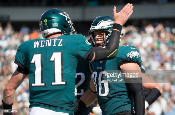 Carson Wentz of the Philadelphia Eagles celebrates with Zach Ertz after scoring a touchdown in the third quarter against the New York Giants at...