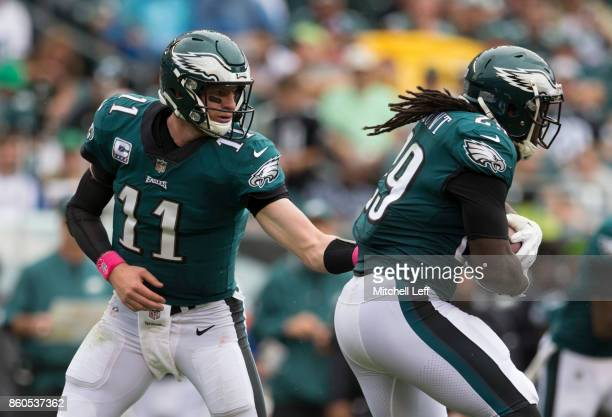 Carson Wentz of the Philadelphia Eagles hands the ball off to LeGarrette Blount against the Arizona Cardinals at Lincoln Financial Field on October 8...