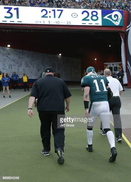 Carson Wentz of the Philadelphia Eagles is escorted off the field at the end of the third quarter during the game against the Los Angeles Rams at the...