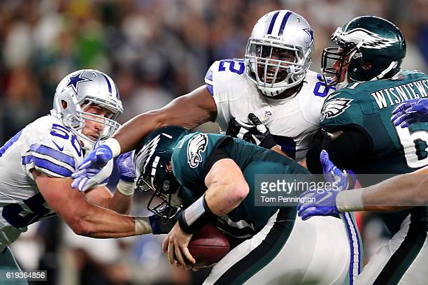 Carson Wentz of the Philadelphia Eagles is sacked by Sean Lee and Cedric Thornton of the Dallas Cowboys in the fourth quarter during a game between...