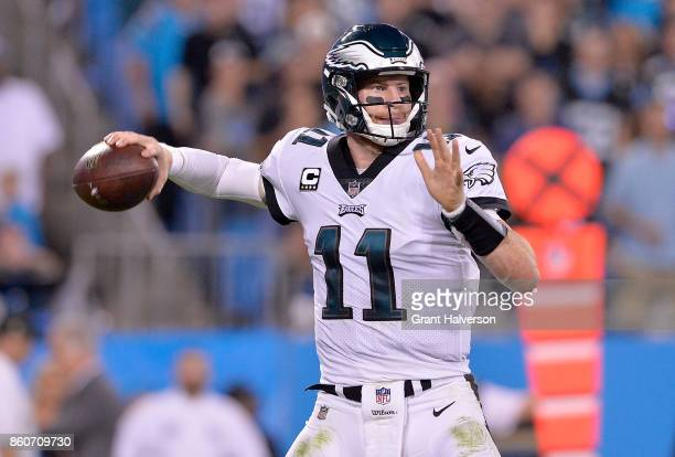 Carson Wentz of the Philadelphia Eagles looks to pass against the Carolina Panthers during their game at Bank of America Stadium on October 12 2017...