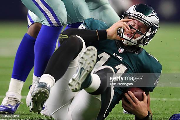 Carson Wentz of the Philadelphia Eagles reacts after being sacked in the fourth quarter during a game between the Dallas Cowboys and the Philadelphia...