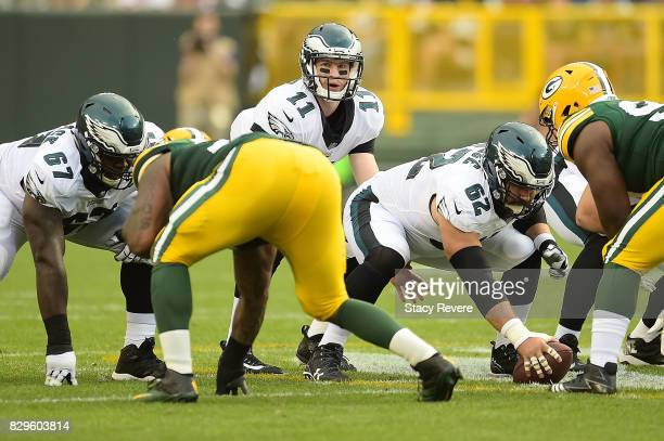 Carson Wentz of the Philadelphia Eagles waits for a snap during the first quarter of a preseason game against the Green Bay Packers at Lambeau Field...