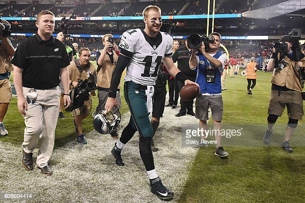 Carson Wentz of the Philadelphia Eagles walks off the field following a victory over the Chicago Bears at Soldier Field on September 19 2016 in...