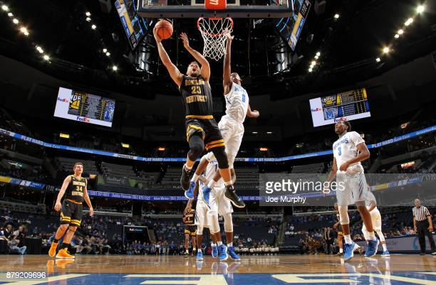 Carson Williams of the Northern Kentucky Norse drives to the basket for a layup against Kyvon Davenport of the Memphis Tigers on November 25 2017 at...