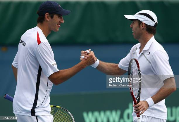 Carsten Ball and Paul Hanley of Australia celebrate after defeating TsungHua Yang and ChuHuan Yi of Chinese Taipei in their doubles match during day...