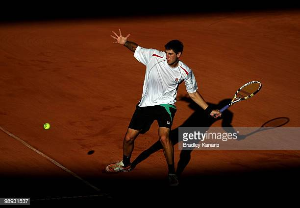 Carsten Ball of Australia plays a forehand during his match against Tatsuma Ito of Japan during the match between Australia and Japan on day three of...