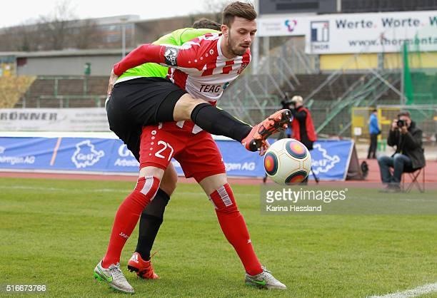 Carsten Kammlott of Erfurt is challenged by Alexander Bittroff of Chemnitz during the Third League match between FC Rot Weiss Erfurt and Chemnitzer...