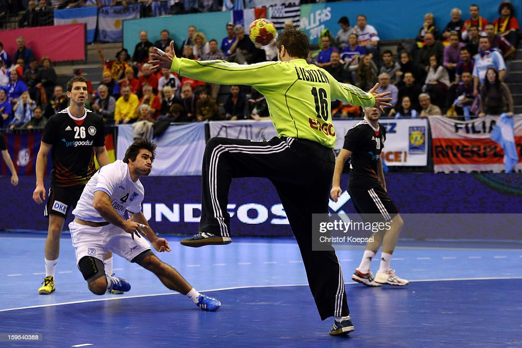 Carsten Lichtlein of Germany (R) saves a shot of Sebastian Simonet of Argentina (L) during the premilary group A match between Germany and Argentina at Palacio de Deportes de Granollers on January 15, 2013 in Granollers, Spain. The match betwwen germany and Argentina ended 31-27.