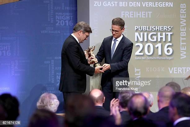 Carsten Linnemann awards Michael Kleinemeier during the VDZ Publishers' Night 2016 at Deutsche Telekom's representative office on November 7 2016 in...