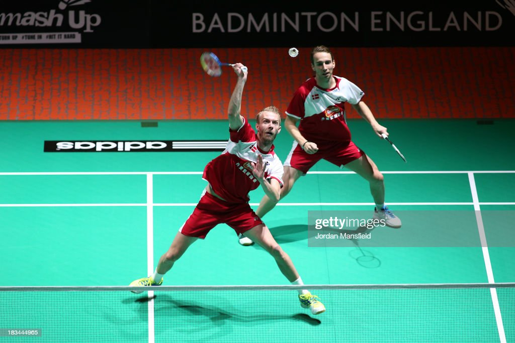 Carsten Mogensen (front) and Mathian Boe (back) of Denmark in action during the Men's Doubles Final with his partner against Berry Angriawan and Ricky Karanda Suwardi of Indonesia during Day 6 of the London Badminton Grand Prix at The Copper Box on October 6, 2013 in London, England.