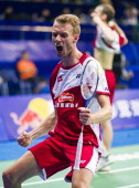 Carsten Mogensen and Mathias Boe of Denmark celebrate after winning their men's doubles semifinal match against Kim Kj Jung and Kim Sa Rang of South...
