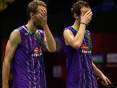 Carsten Mogensen and Mathias Boe of Denmark swipe their sweat during the match between Mathias Boe and Carsten Mogensen of Denmark and Mohammad Ahsan...