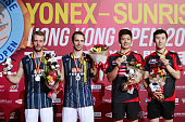 Carsten Mogensen Mathias Boe Lee Yong Dae and Yoo YeonSeong pose for a picture with their medals after the match between Yoo Yeon Seong and Lee Yong...