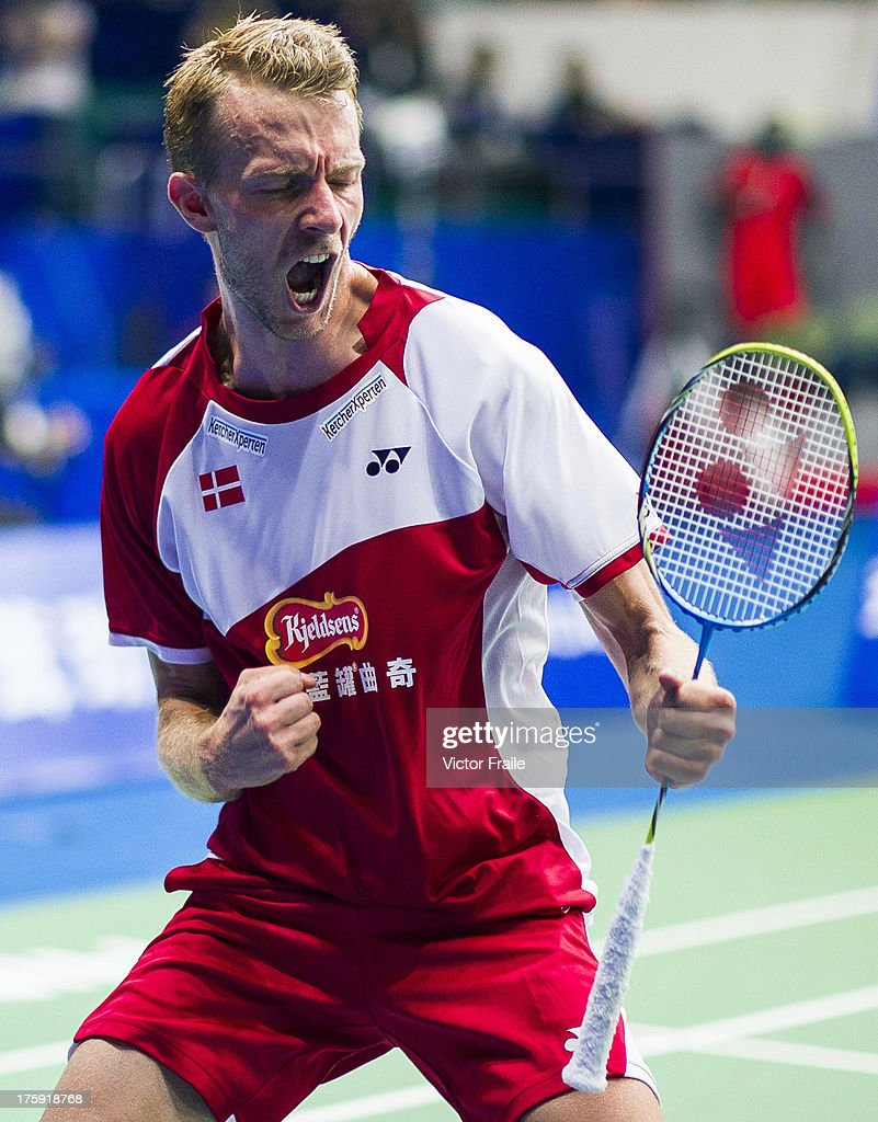 <a gi-track='captionPersonalityLinkClicked' href=/galleries/search?phrase=Carsten+Mogensen&family=editorial&specificpeople=651076 ng-click='$event.stopPropagation()'>Carsten Mogensen</a> of Denmark celebrates after winning with his team mate Mathias Boe (not pictured) their men's doubles semifinal match against Kim Kj Jung and Kim Sa Rang of South Korea during the Badminton World Championships at the Tianhe Gymnasium on August 10, 2013 in Guangzhou, China.