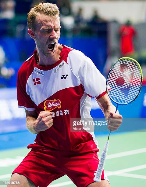 Carsten Mogensen of Denmark celebrates after winning with his team mate Mathias Boe their men's doubles semifinal match against Kim Kj Jung and Kim...