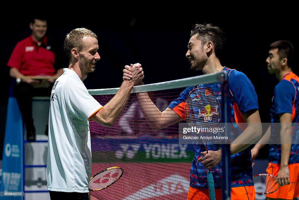 <a gi-track='captionPersonalityLinkClicked' href=/galleries/search?phrase=Carsten+Mogensen&family=editorial&specificpeople=651076 ng-click='$event.stopPropagation()'>Carsten Mogensen</a> of Denmark clashes hands with <a gi-track='captionPersonalityLinkClicked' href=/galleries/search?phrase=Chai+Biao&family=editorial&specificpeople=6130648 ng-click='$event.stopPropagation()'>Chai Biao</a> of China after winning their Men,s Doubles match during day three of the BWF Dubai World Superseries 2015 Finals at the Hamdan Sports Complex on on December 11, 2015 in Dubai, United Arab Emirates.