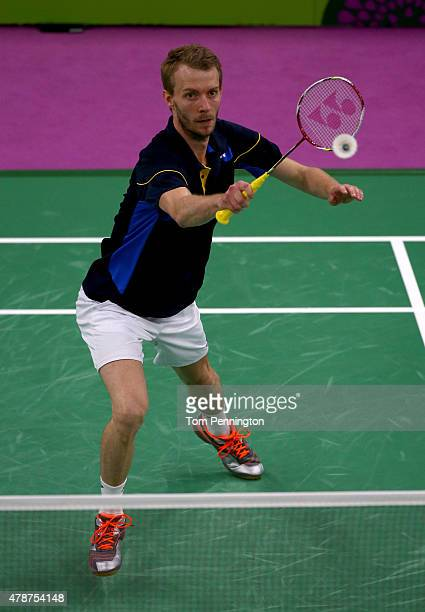 Carsten Mogensen of Denmark competes in the Men's Badminton Doubles final against Vladimir Ivanov and Ivan Sozonov of Russia on day fifteen of the...