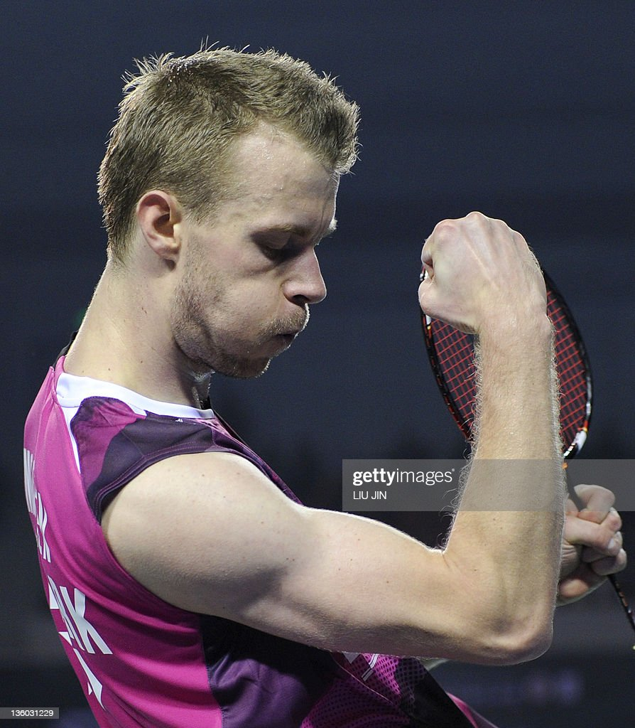 <a gi-track='captionPersonalityLinkClicked' href=/galleries/search?phrase=Carsten+Mogensen&family=editorial&specificpeople=651076 ng-click='$event.stopPropagation()'>Carsten Mogensen</a> of Denmark reacts to winning a point against Ko Sung-Hyun and Yoo Yeon-Seong of South Korea during their men's doubles semi-final match of the BWF badminton World Superseries Finals in Liuzhou city, China's southern province of Guangxi on December 17, 2011. The Danish couple won the match 16-21, 21-12, 21-13. AFP PHOTO / LIU JIN