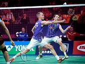 Carsten Mogensen og Mathias Boe of Denmark in action during Day Two at the MetLife BWF World Superseries Premier Yonex Denmark Open Badminton at...