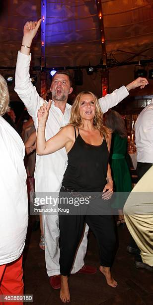 Carsten ThammWalz and Kim Fisher attend the Udo Walz Celebrates His 70th Birthday at BAR jeder Vernunft on July 28 2014 in Berlin Germany