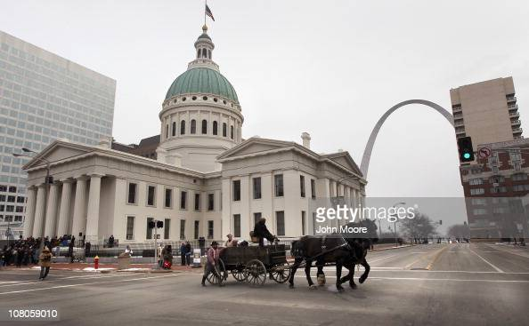 A cart carries off a group of people portraying slaves during the staging of a reenactment of a mid19th century slave auction January 15 2011 in...