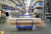 A cart of lumber is pushed through a Lowe's store by a customer in Sunnyvale California Monday Aug 20 2007 Lowe's Cos the secondlargest US...